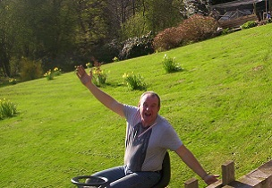 john at oakford cottage, whatstandwell mowing his lawn